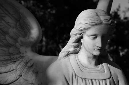 A black and white shot of a melancholy looking angel Archivio Fotografico
