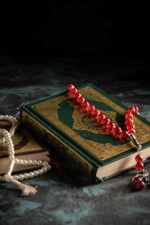 Islamic concept for eid and ramadan: The holy qoran with tasbih (rosary beads)