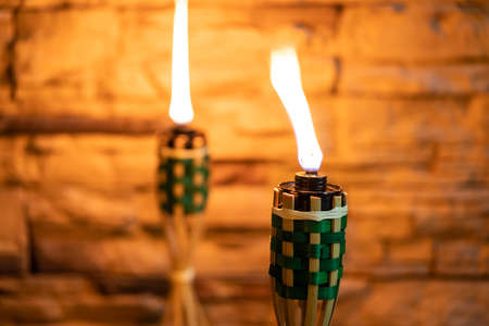 Bamboo oil lamp or pelita for eid or hari raya decoration with copy space for text