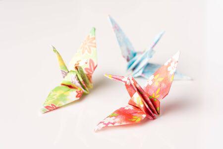 Japanese crane origami isolated against white background Archivio Fotografico