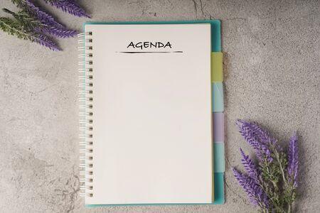 Agenda wordings on blank notebook, copy space for text 版權商用圖片