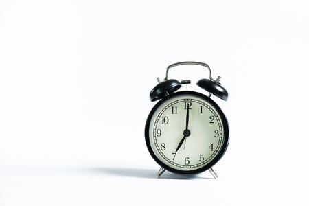 A black alarm clock isolated against white background