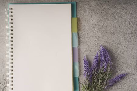 Blank notebook on white table with copy space for text