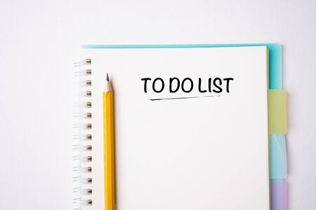 TO DO LIST wordings on a notebook on a table, flat lay composition, copy space for text