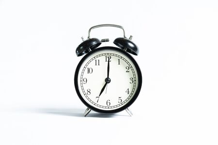 A black alarm clock isolated against white background Imagens