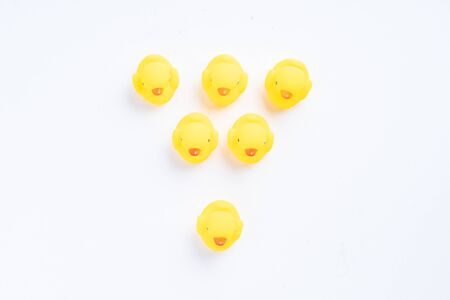 a group of yellow rubber duck with one duck facing different direction