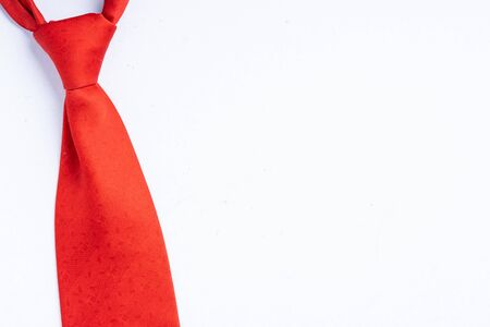 Red neck tie isolated on white with copy space for text