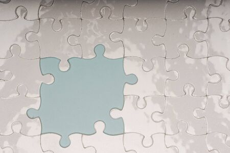 Closed up shot of blank white puzzle pieces, selective focus, copy space for text Banco de Imagens