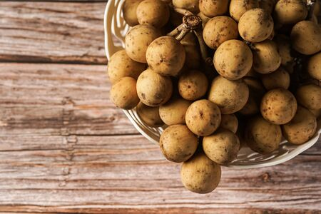 Lansium parasiticum, commonly known in English as langsat or lanzones, is a species of tree in the Mahogany family with commercially cultivated edible fruits. The species is native to South East Asia