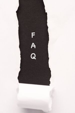 FAQ wordings on a torn paper background