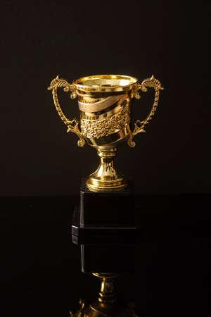 Trophy replica isolated against black Archivio Fotografico