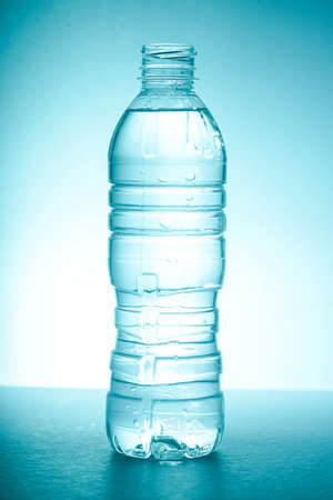 Bottle fills with water, isolated Imagens