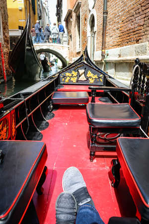 first person view of riding a gondola in the beautiful Grand Canal, Venice, Italy