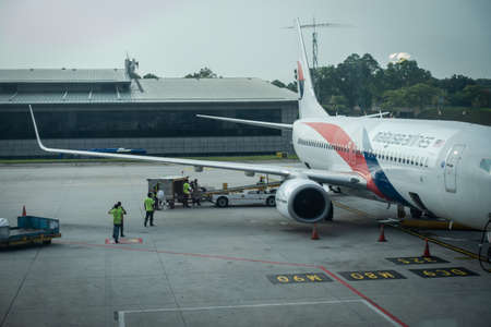 Malaysia Airlines planes prepare for passengers to board, as ground crew prepares the plane for the flight Editorial