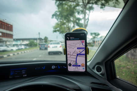 An iPhone X with Waze navigation app inside the car. Waze has gain popularity for its good navigation.