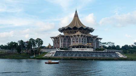 Sarawak River Cruise boat cruising along Sarawak River in Kuching Waterfront