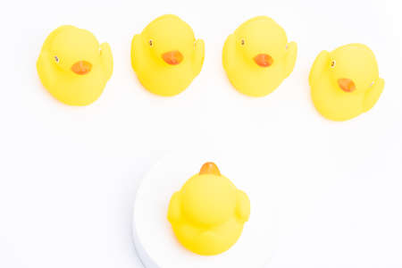Leadership concept. A group of yellow rubber duck following the leader Stockfoto