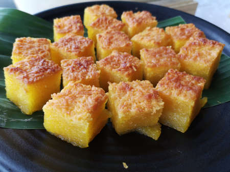 Bingka Jagung. A Malay traditional Kuih. It is a mixture of flour, custard, corn cream and other item, baked and served fresh. Have a sweet taste. Soft inside and crunchy on top.
