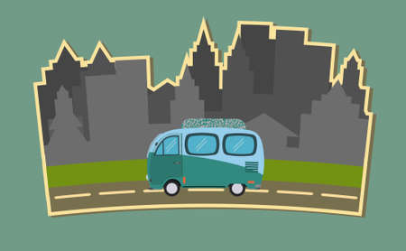 Van on the road against the background of the city