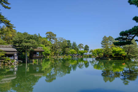 Pond and tea house in Kenrokuen, a japanese garden in Kanazawa, Ishikawa prefecture, Japan Stock Photo