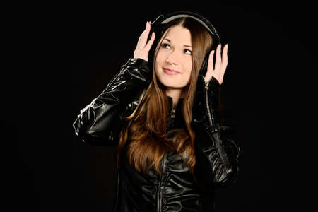 Young woman with big headphones enjoying good music