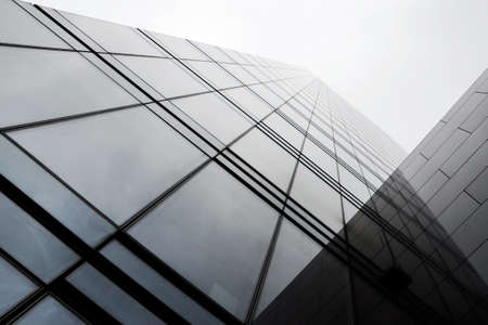 New architecture in western Europe made of glass, steel, stone and concrete, taken on a rainy day