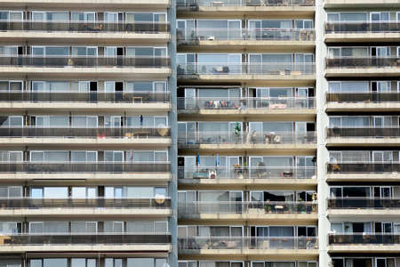 Balcony, windows and doors at a big apartment building in Brussel, side view Stock Photo