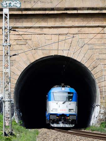 Czech railways EC train with a modern electric locomotive in a long tunnel Editorial
