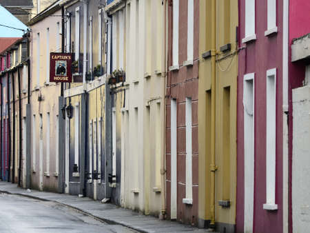 narrow street: Narrow street with colorful houses in a town Dingle in Ireland