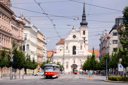 Busy street Jostova with trams and lots of people Editorial