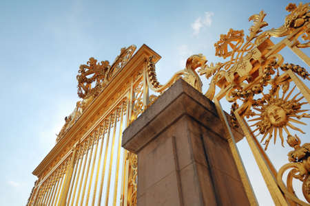 Golden decorated gateway to Versailles Chateau Stock Photo