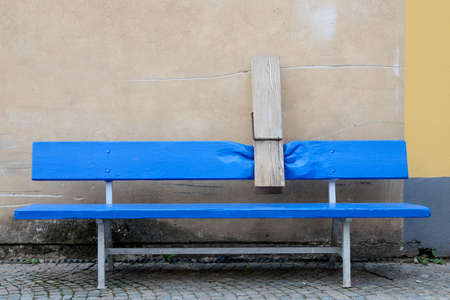 Blue old bench with a pin street art Stock Photo