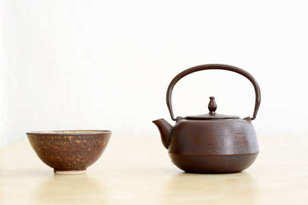 Minimalistic japanese tea set (cup and teapot) on white background Stock Photo