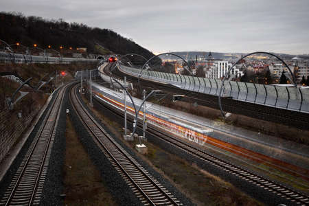 New Connection railway system in the evening with one blured train Stock Photo