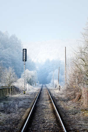 Local railway in Czech Republic in sunny and misty winter weather photo