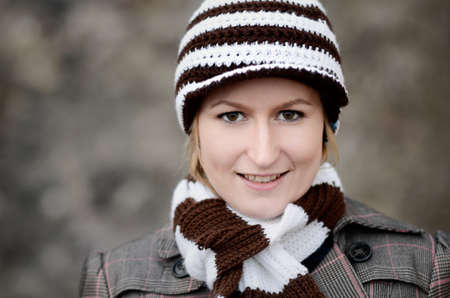 Woman with striped woolen hat and scarf