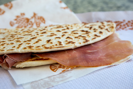 the awesome, world famous, delicious, tasty piadina romagnola with prosciutto crudo ham. Italian summer mood. Imagens