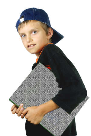 the boy holds the book in hands.