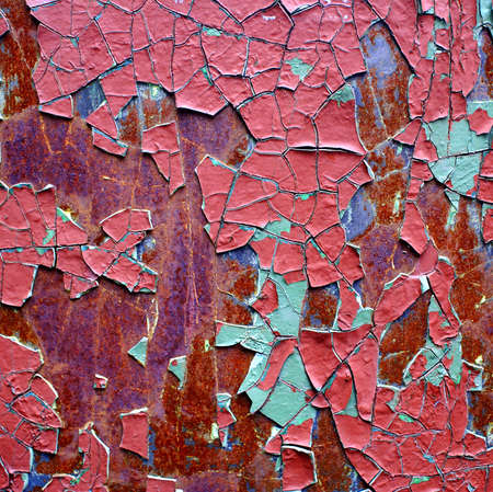 rusty iron sheet with corrosion steins and the cracked paint. photo