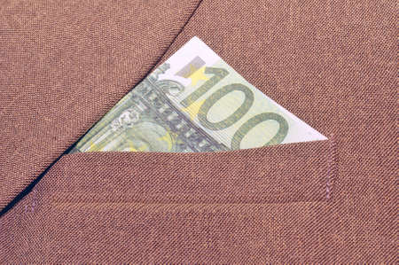 breast pocket: banknote              in a breast pocket of a jacket. Stock Photo