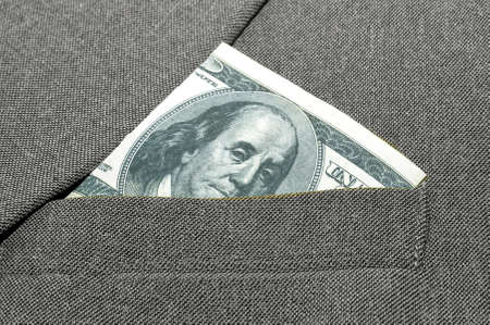 breast pocket: banknote in a breast pocket of a jacket.