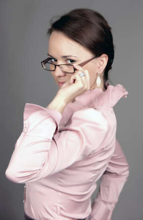 estimating: the serious young woman in glasses  Stock Photo