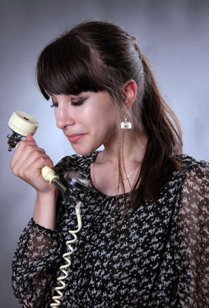 speaks: the young girl speaks by phone