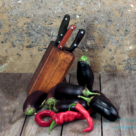knifes: kitchen knifes red pepper and eggplants  Stock Photo