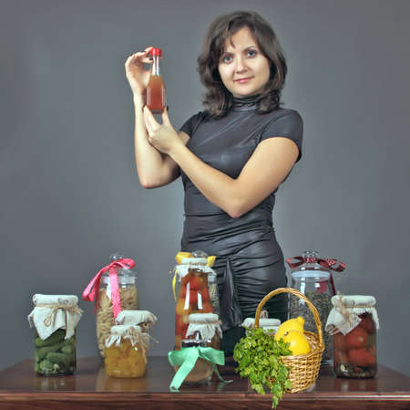sause: the young woman tells preparation tasty health peeping meal  Stock Photo