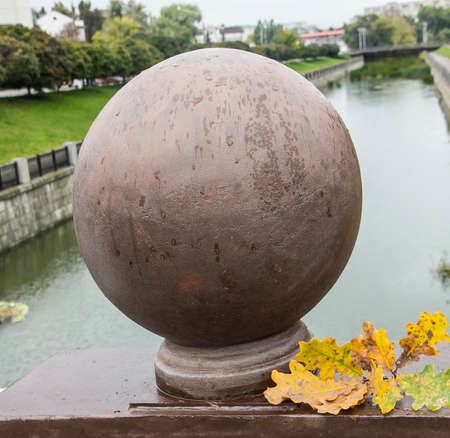A decorative sphere and branch of oak leaves  Фото со стока