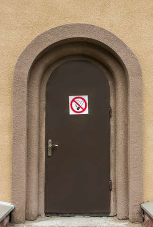 With a precantionary sign   to Smoke a door it is forbidden  photo