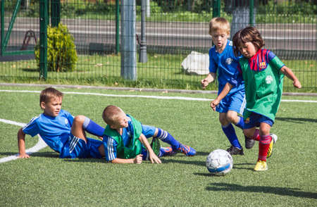 Small children play football  Editorial