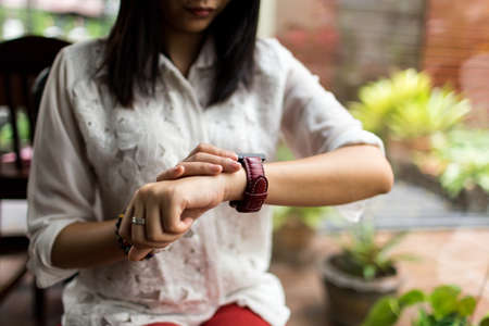 watch: woman looking at her smart watch Stock Photo