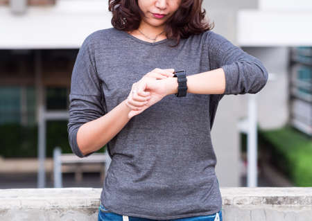 looking at watch: A femalewoman looking at her smart watch